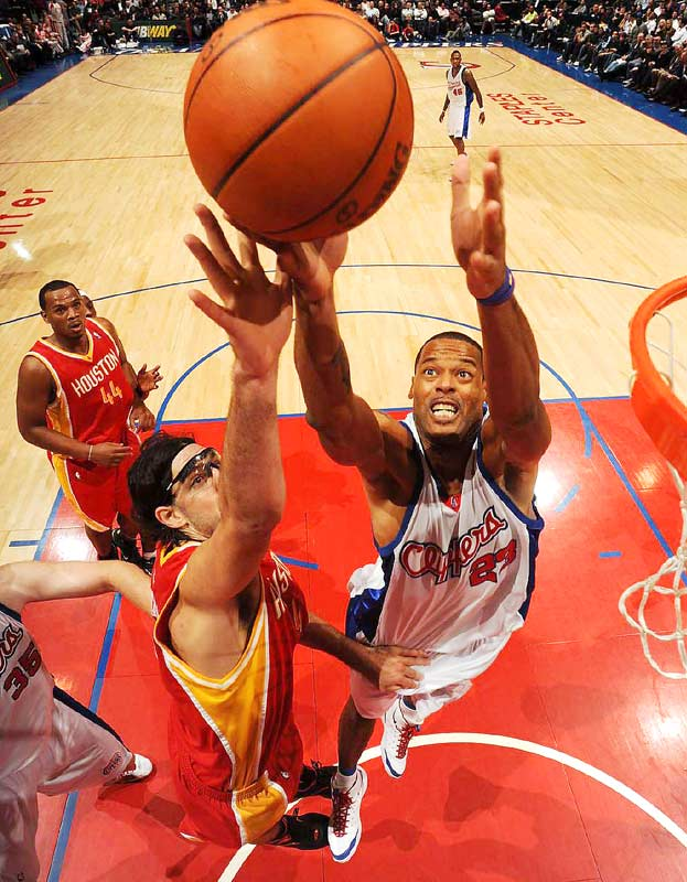 Houston's Luis Scola (left) goes up against Marcus Camby of the Clippers during the Rockets' 102-85 win at L.A.'s Staples Center on Dec. 2.