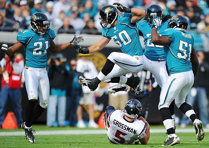 A slew of Jaguars  -- Russell Allen (50) , Clint Ingram (51), Reggie Nelson (25) and Derek Cox (21) -- do their best not to hit a sliding Rex Grossman after the Houston quarterback tried to get out of harms way during a 23-18 loss at Jacksonville on Dec. 6.