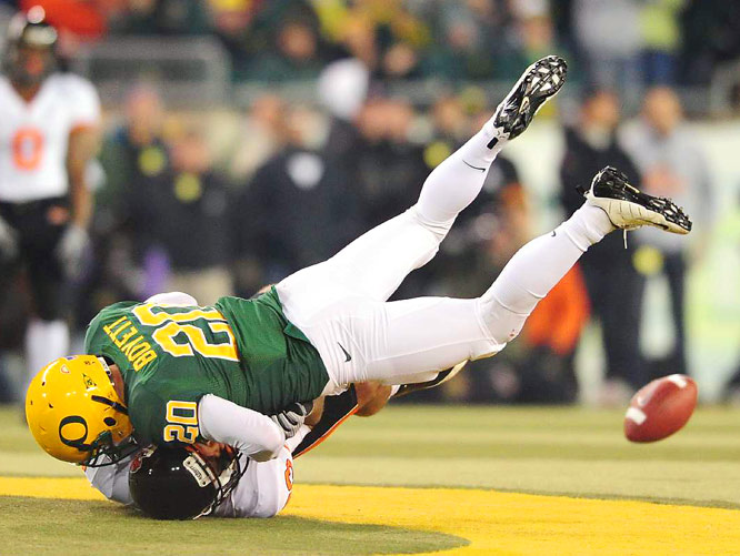 Oregon safety John Boyett drives Oregon State wideout Jordan Bishop into the turf while successfully defending a pass during his team's 37-33 victory at Autzen Stadium on Dec. 3.