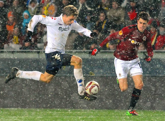 Jasper Gronkjaer of FC Copenhagen (left) vies for the ball with Ondrej Kusnir of Sparta Prague during the UEFA Europa League Group K match on Dec. 16 in Prague. FC Copenhagen won 3-0.