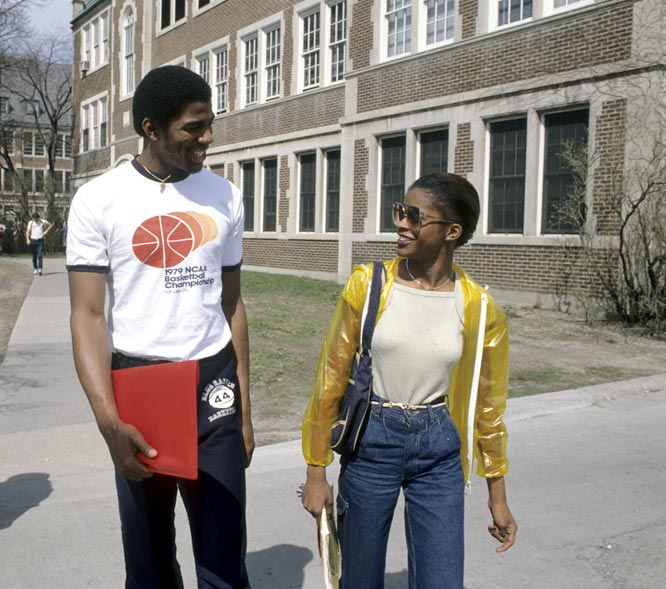 Magic and a fellow student exchange pleasantries during a stroll through campus.