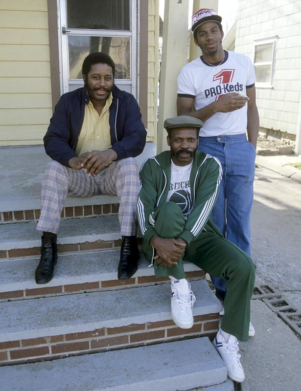 Magic hangs out at home with dad, Earvin Sr. (left) and friend Charles Tucker.
