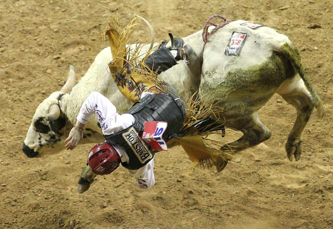 "Bull rider Tate Stratton from Kellyville, Okla., gets thrown by ""Bailey Hou"" during the 9th round. Stratton placed 7th overall."