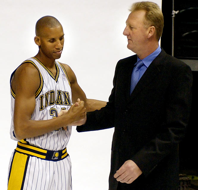 Reggie Miller greets Larry Bird during the Pacers' media day in Indianapolis.