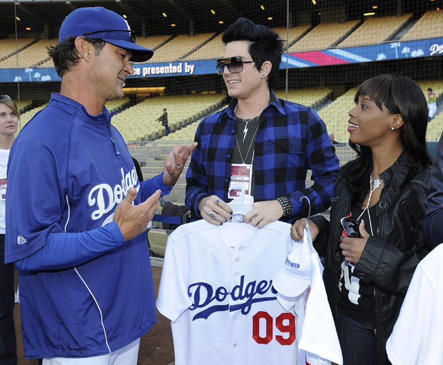 Los Angeles Dodgers hitting coach Don Mattingly talks with Season 8 contestants Adam Lambert and Lil Rounds before a Dodgers game.