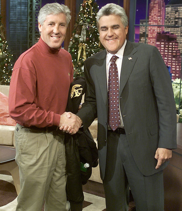 USC coach Pete Carroll shakes hands with Leno prior to the Trojans' matchup with Michigan at the 2003 Rose Bowl
