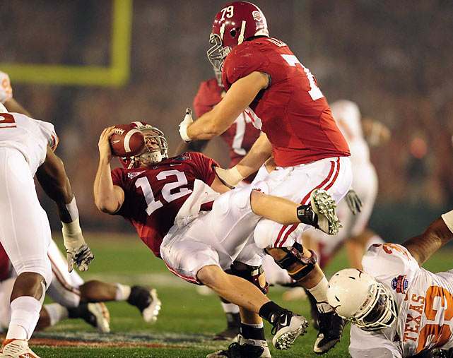 Greg McElroy takes a tumble in the second half, but to his credit he didn't turn the ball over all night.