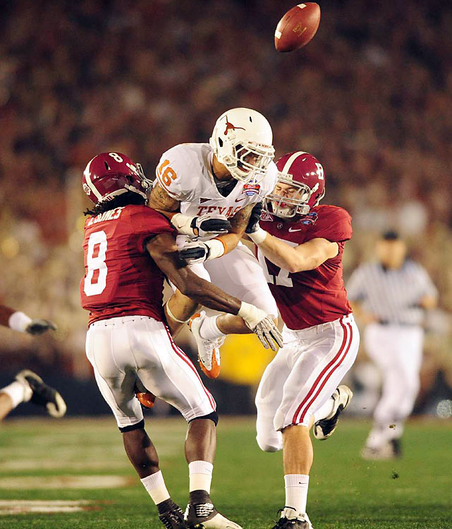 Brock Fitzhenry of Texas battles with Julio Jones and Brad Smelley on a kickoff that the Longhorns recovered after Alabama failed to field the ball.