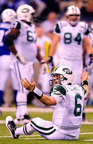 Mark Sanchez of the Jets looks for a roughing-the-passer flag that never came.