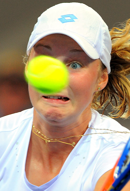 Ekaterina Makarova of Russia keeps her eye on the ball during her loss to Alicia Molik of Australia in the first round of the Brisbane International on Jan. 3. Molik won the match 6-4, 1-6, 6-4.