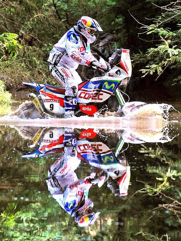 Chile's Francisco Lopez Contardo is reflected in the water as he rides his Aprilia during Stage 1 of the Dakar 2010 between Colon and Cordoba, Argentina, on Jan. 2. France's David Casteu won the stage.