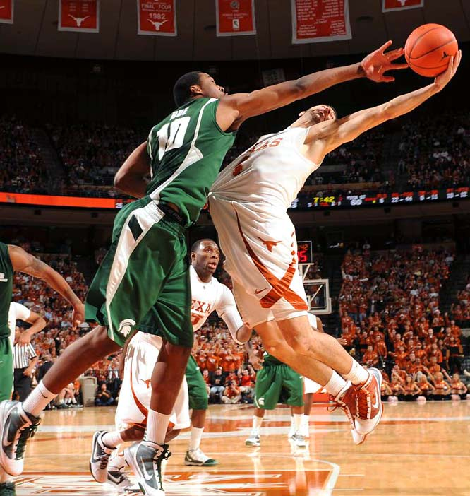 Michigan State forward Delvon Roe battles with Texas guard Dogus Balbay at the Frank Erwin Special Events Center in Austin. The pair had eights points each as Texas defeated Michigan State 79-68.