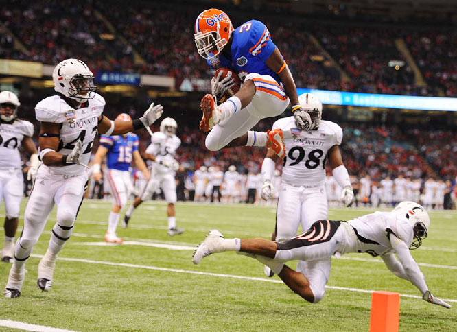 Florida running back Chris Rainey leaps over Cincinnati defensive back Dominique Battle for a touchdown during the Gators 51-24 win in the Sugar Bowl in New Orleans on Jan. 1.