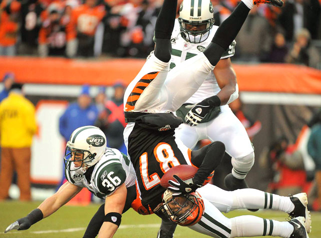 New York Jets safety Jim Leonhard tackles Cincinnati Bengals wide receiver Andre Caldwell during the first half of their playoff game at Paul Brown Stadium on Jan. 9. The play was ruled a completion but was overturned after a challenge by the Jets. The Jets defeated the Bengals 24-14 in the wild-card round.