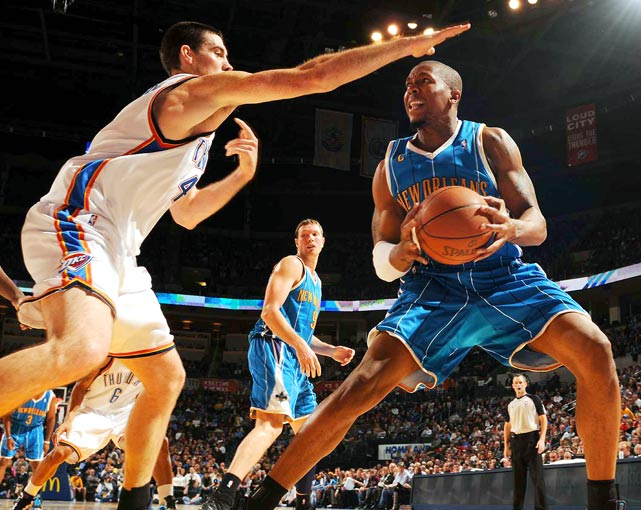 Forward David West of the New Orleans Hornets is confronted by forward Nick Collison of the Oklahoma City Thunder during their game at the Ford Center in Oklahoma City Jan. 6. West had 19 points as the Hornets defeated the Thunder 97-92.
