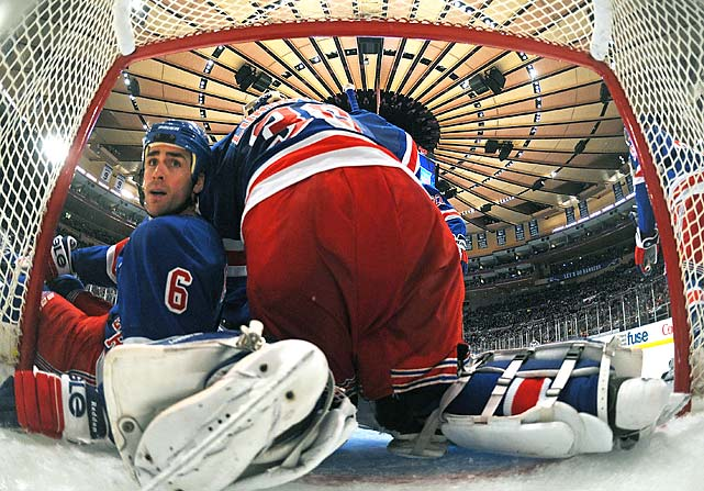 Wade Redden and goaltender Henrik Lundqvist of the New York Rangers collide during the second period against the Ottawa Senators at Madison Square Garden on Jan. 14, in New York. The Senators defeated the Rangers 2-0.