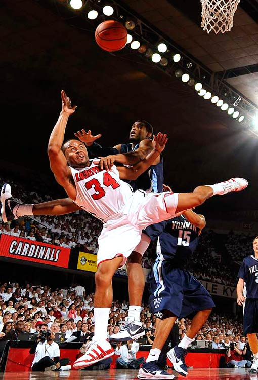 Louisville Cardinal guard Jerry Smith gets fouled by Villanova Wildcat forward Antonio Pena at Freedom Hall in Louisville. The Wildcats won 92-84.