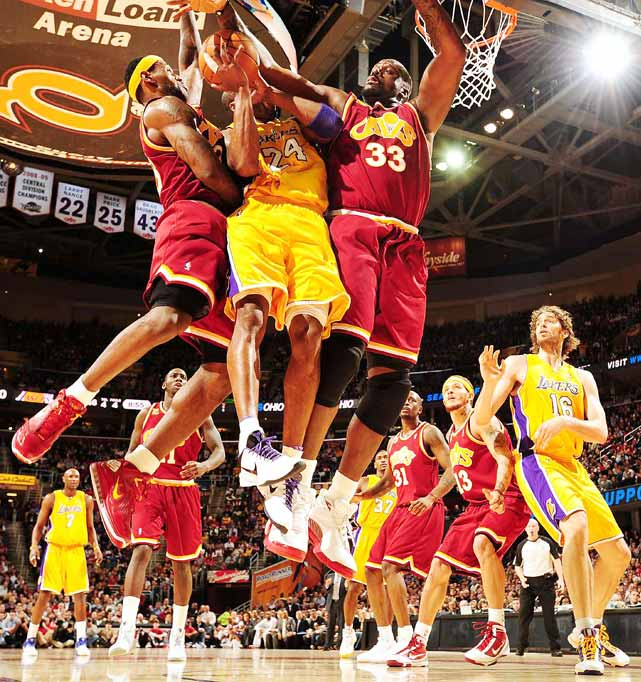 Kobe Bryant of the Los Angeles Lakers gets fouled as he goes up for a shot between LeBron James and Shaquille O'Neal of the Cleveland Cavaliers on Jan. 21 at The Quicken Loans Arena in Cleveland. The Cavs won 93-87.