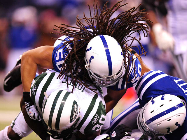 Indianapolis Colts linebacker Philip Wheeler tackles New York running back Thomas Jones during the AFC Championship game.