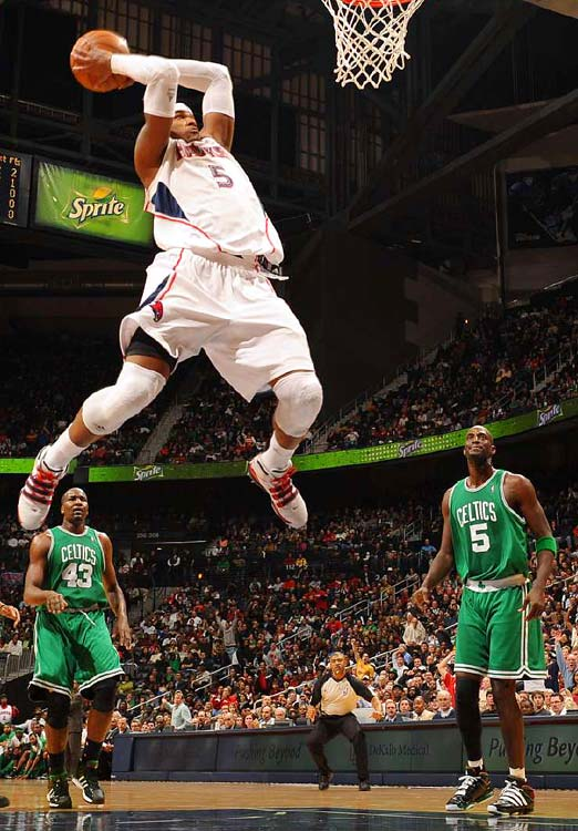 The Hawks' Josh Smith goes up for a dunk as Boston's Kendrick Perkins and Kevin Garnett can only watch during Atlanta's 100-91 home victory on Jan. 29. The Hawks improved to 4-0 this season against the Celtics.