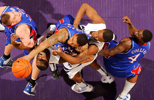 Kansas center Cole Aldrich (left, in blue), forward Markieff Morris (center) and guard Sherron Collins vie for a rebound against Kansas State forwards Jamar Samuels and Wally Judge during their Jan. 30 game in Manhattan, Kan. The second-ranked Jayhawks won 81-79 in overtime.