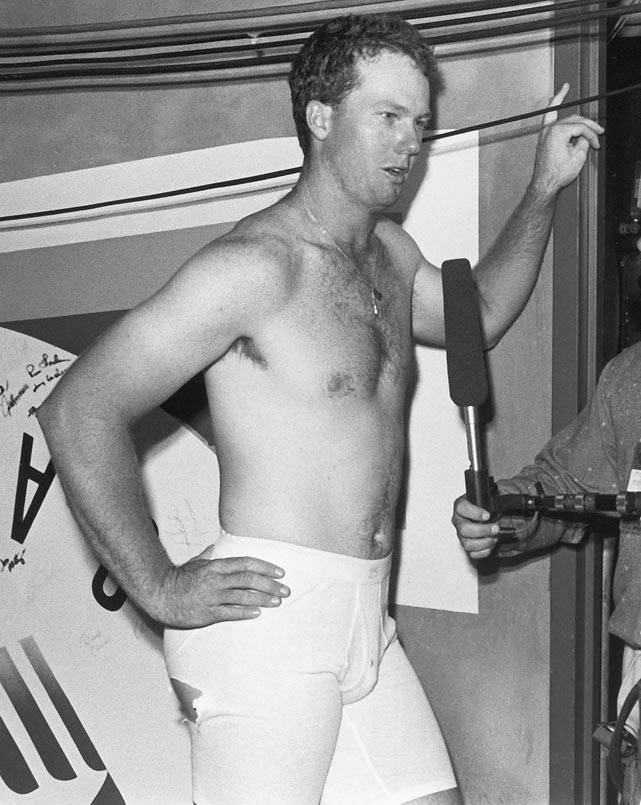 McGwire talks to reporters in the locker room following the 1987 MLB All Star Game.