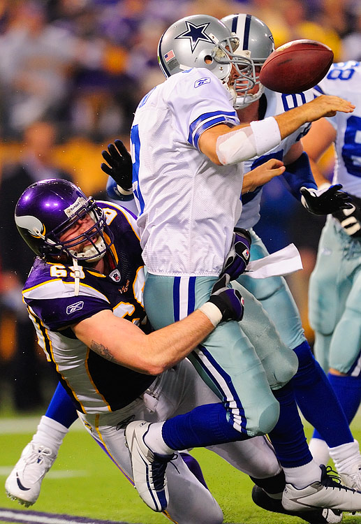 Tony Romo was sacked six times, threw one interception and lost two of three fumbles, including this one after being hit by Jared Allen.