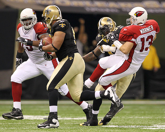 After being intercepted in the second quarter, Arizona quarterback Kurt Warner was drilled by Bobby McCray (93) during the run back.