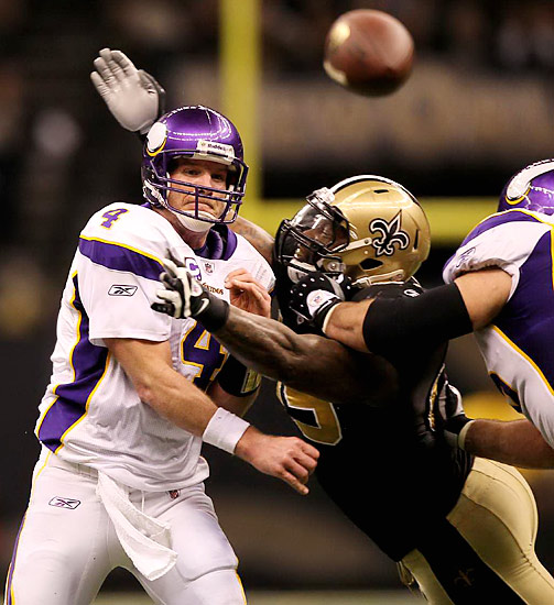 Minnesota quarterback Brett Favre spent most of the game throwing under pressure by the Saints.