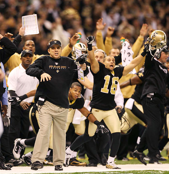Coach Sean Payton of the Saints reacts as Garrett Hartley (not shown) makes the game-winning field goal in overtime.