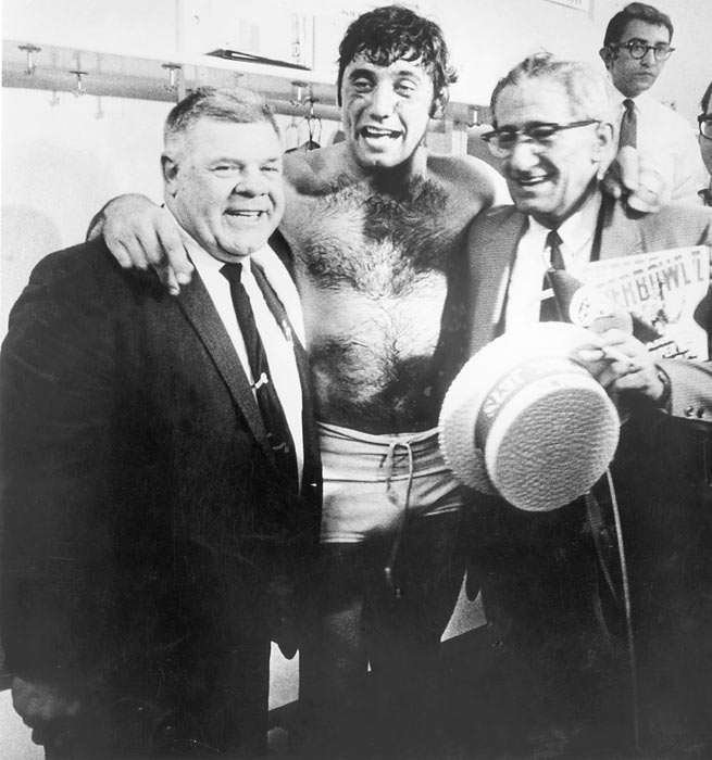Namath celebrates the Jets victory with his father and coach Weeb Ewbank.