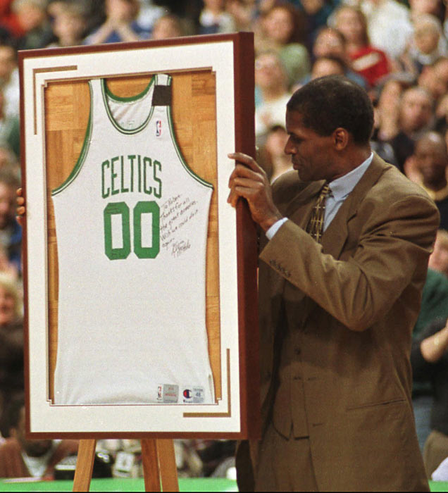 Former Boston Celtics center Robert Parish is honored by having his No. 00 raised to the FleetCenter rafters at halftime of a game vs. Indiana.