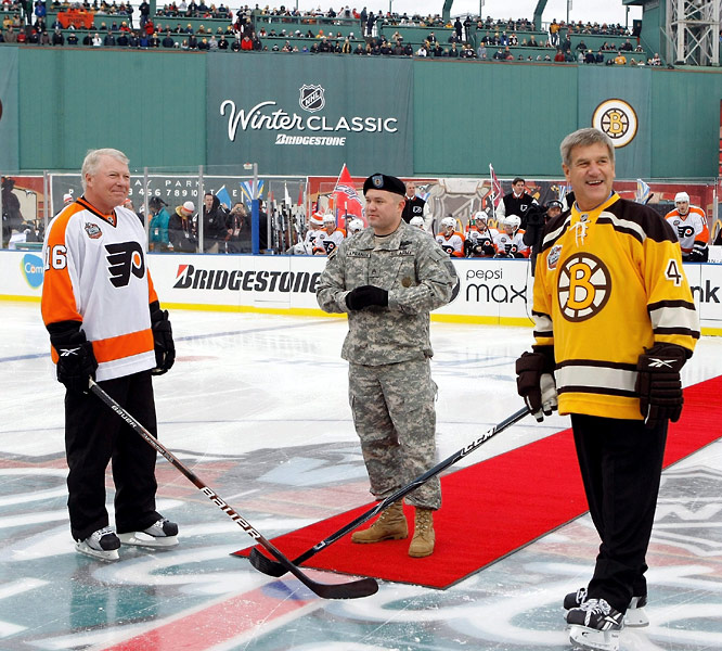 Honorary captains Bobby Clarke (left) and Bobby Orr met at center ice for the ceremonial drop of the puck.