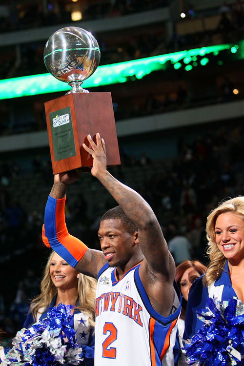 In its 26th year, the NBA All-Star dunk contest got a first this season: it's first three-time champion. Knicks guard Nate Robinson (left), who is listed at only 5-foot-9, defeated Raptors' rookie DeMar DeRozan in the finals to claim his third dunk-contest trophy. <br><br>Here are some of the best shots from Saturday's contest in Dallas.