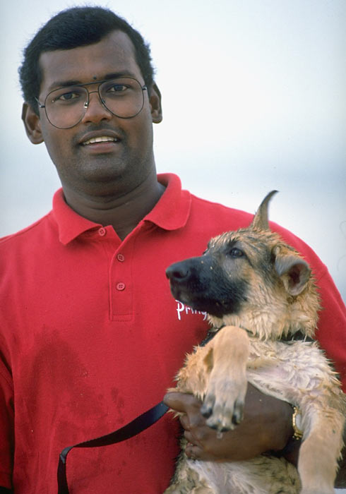 Vijay Singh and his dog take time out for a quick photo during a tour event in Ponte Vedra, Fla.