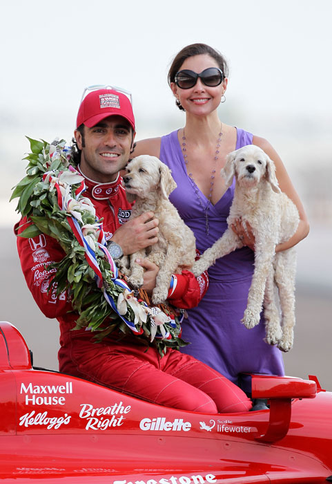 Dario Franchitti poses with Ashley Judd and their dogs after winning the 2012 Indianapolis 500.