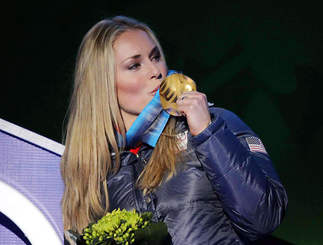 The 2010 SI Swimsuit model accepts her gold medal at the ceremony on Wednesday night.