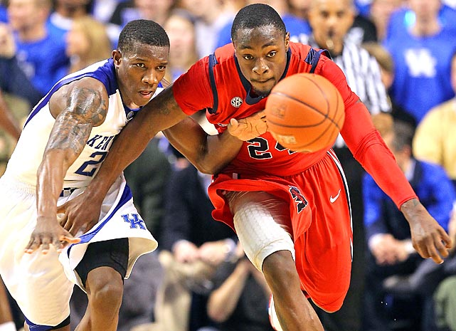 Eric Bledsoe of the Kentucky Wildcats and Terrico White of the Ole Miss Rebels reach for a loose ball at Rupp Arena. Kentucky defeated Ole Miss 85-75.