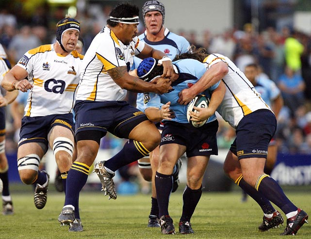 Benn Robinson of the NSW Waratahs is tackled during a Super 14 rugby trial match against the ACT Brumbies at Viking Park on Feb. 4, in Canberra, Australia. The Waratahs defeated the Brumbies 15- 7.