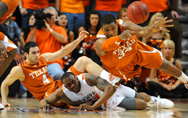 Texas center Dexter Pittman throws the ball upcourt as he battles with Oklahoma State guard James Anderson during the Longhorns' 70-62 road win on Feb. 1.