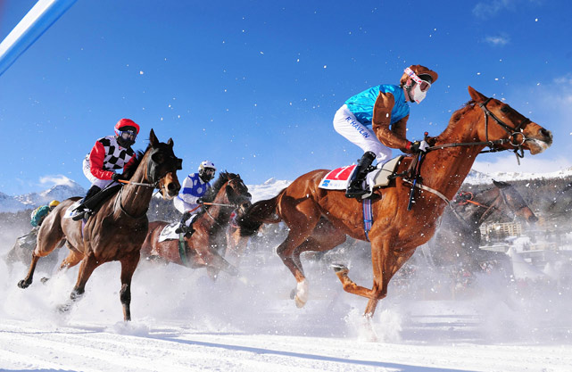 Robert Havlin aboard Just That (right), Georg Bocskai aboard Winterwind (center) and Dane O' Neill aboard  Vlavianus (left) compete during White Turf racing in the snow in St Moritz, Switzerland, Feb. 7. Winterwind won the race.