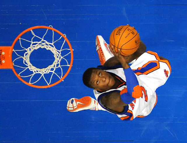 Nate Robinson of the New York Knicks attempts a throw down during the All-Star dunk contest. Robinson won the event for the third time.