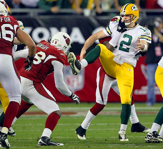 It went on and on, did the Cardinals' Jan. 10 wild-card game against the Packers, the teams like a pair of pugilists delivering blow after blow, each refusing to go down.  Then, just like that, it was over, the Cardinals' knockout blow coming on the fourth play of overtime, when cornerback Michael Adams sacked and stripped Packers QB Aaron Rodgers. Linebacker Karlos Dansby picked up the fumble and raced 17 yards for the touchdown to end the NFL's highest scoring playoff game, 51-45.