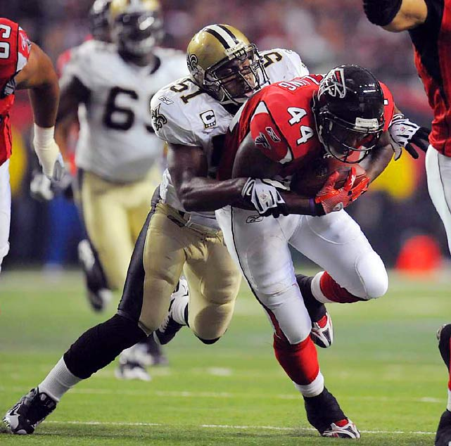 Jonathan Vilma tackled Jason Snelling short of the first-down marker on fourth-and-2 with 1:18 remaining to preserve a New Orleans victory, 26-23, over rival Atlanta.