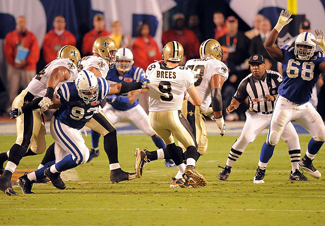 Dwight Freeney's injured ankle didn't keep him out of the game, and in the second quarter he bull-rushed the Saints and sacked Drew Brees.