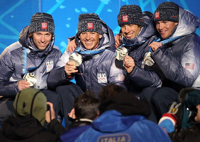 U.S. silver medalists Brett Camerotand, Todd Lodwick, Johnny Spillane and Bill Demong.
