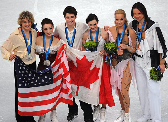 Silver medalists Charlie White and Meryl Davis of the U.S., gold medalists Scott Moir and Tessa Virtue of Canada, and bronze medalists Oksana Domnina and Maxim Shabalin of Russia.