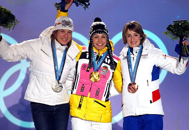 Silver medalist Anastazia Kuzmina of Slovakia, gold medalist Magdalena Magdalena of Germany and bronze medalist Marie Laure Brunet of France.