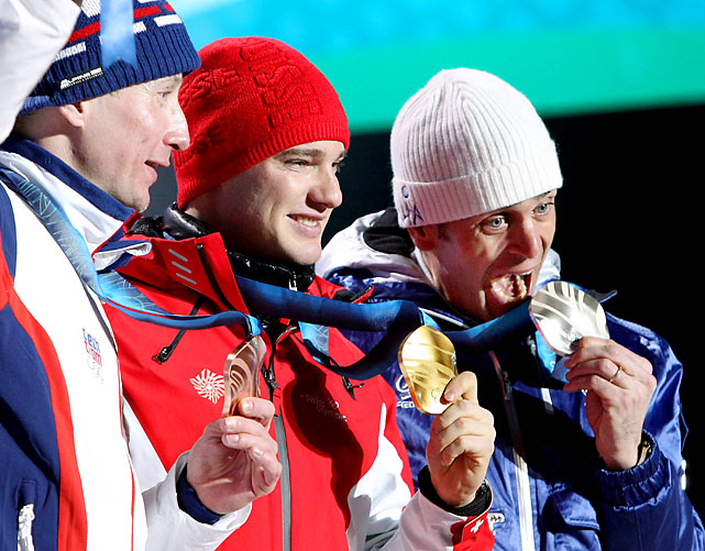 Bronze medalist Lukas Bauer of the Czech Republic, gold medalist Dario Cologna of Switzerland and silver medalist Pietro Piller Cottrer of Italy.