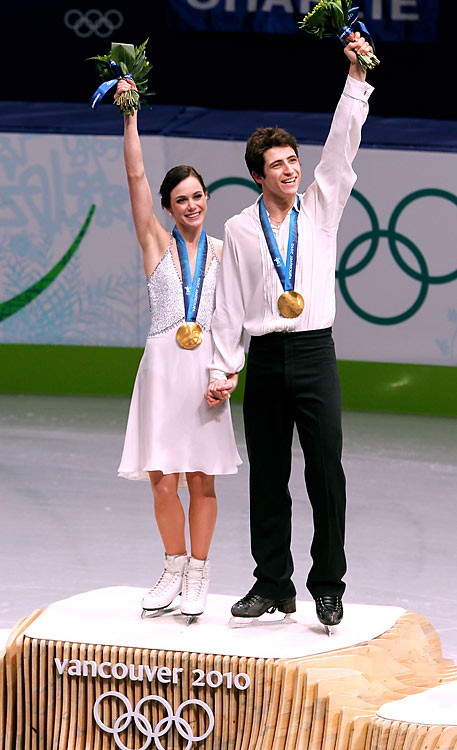 Tessa Virtue and Scott Moir of Canada with their gold.